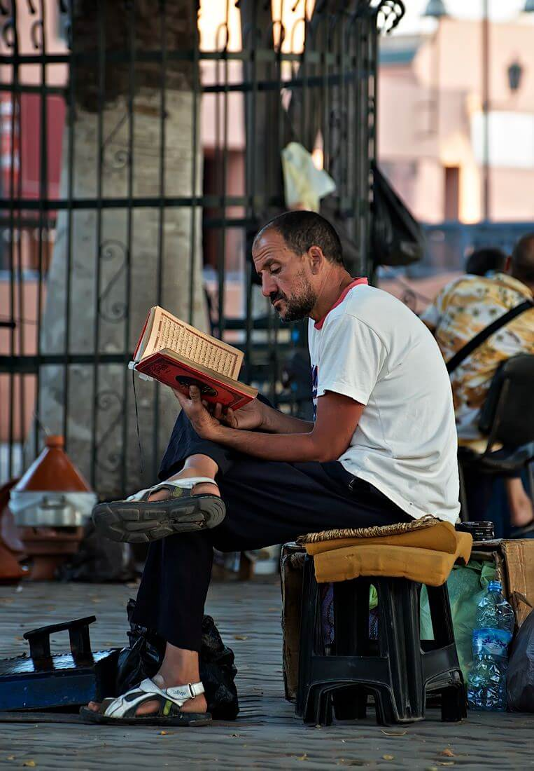 A man in the park reading quran, Marrakech - Photo by Zdenek Sindelar ~ CuriousZed