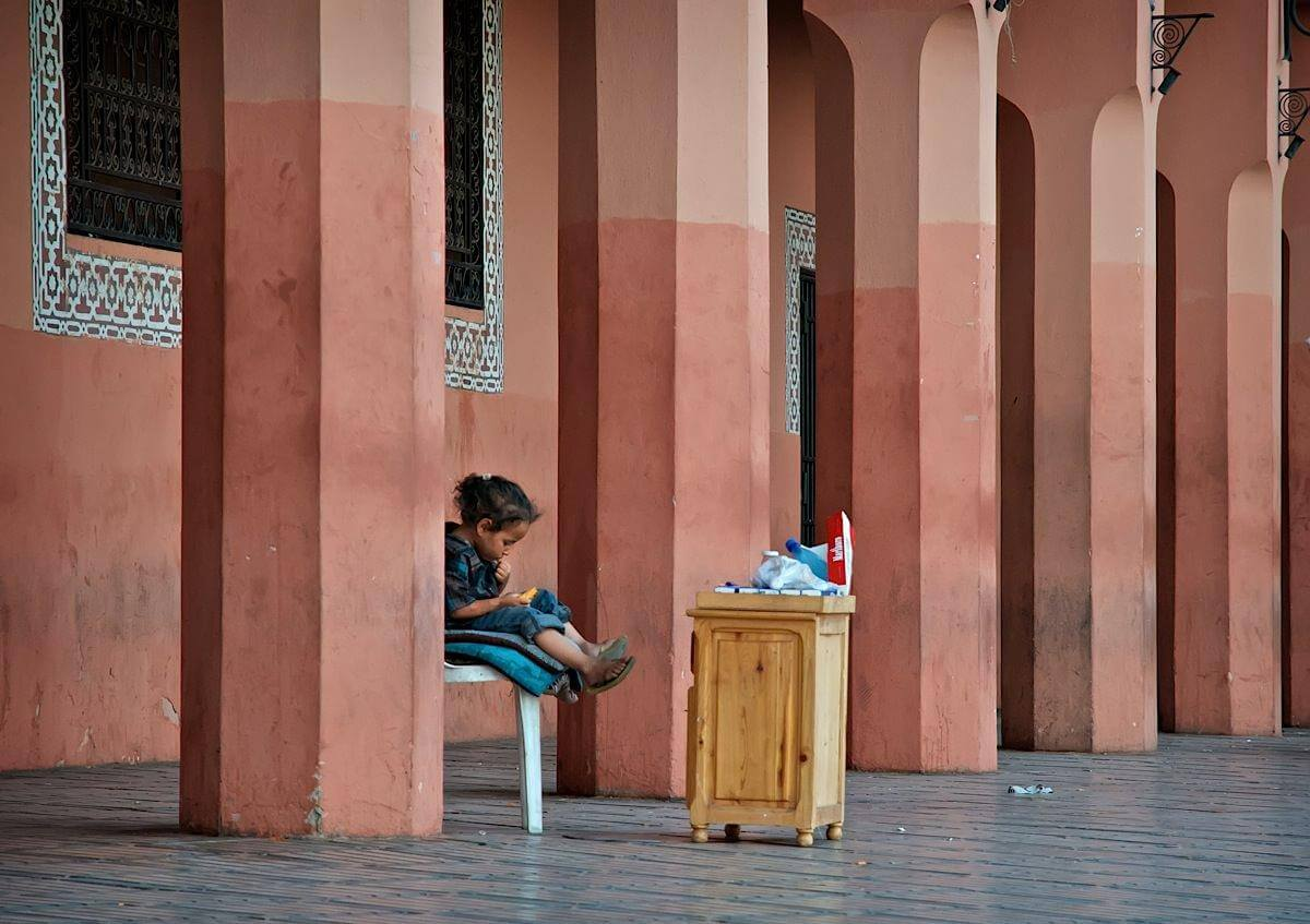 A child selling cigarettes on a street of Marrakech