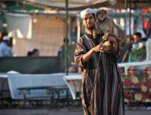 Moroccan man in djellaba with a monkey; Marrakech, Morocco - Photo by Zdenek Sindelar ~ CuriousZed