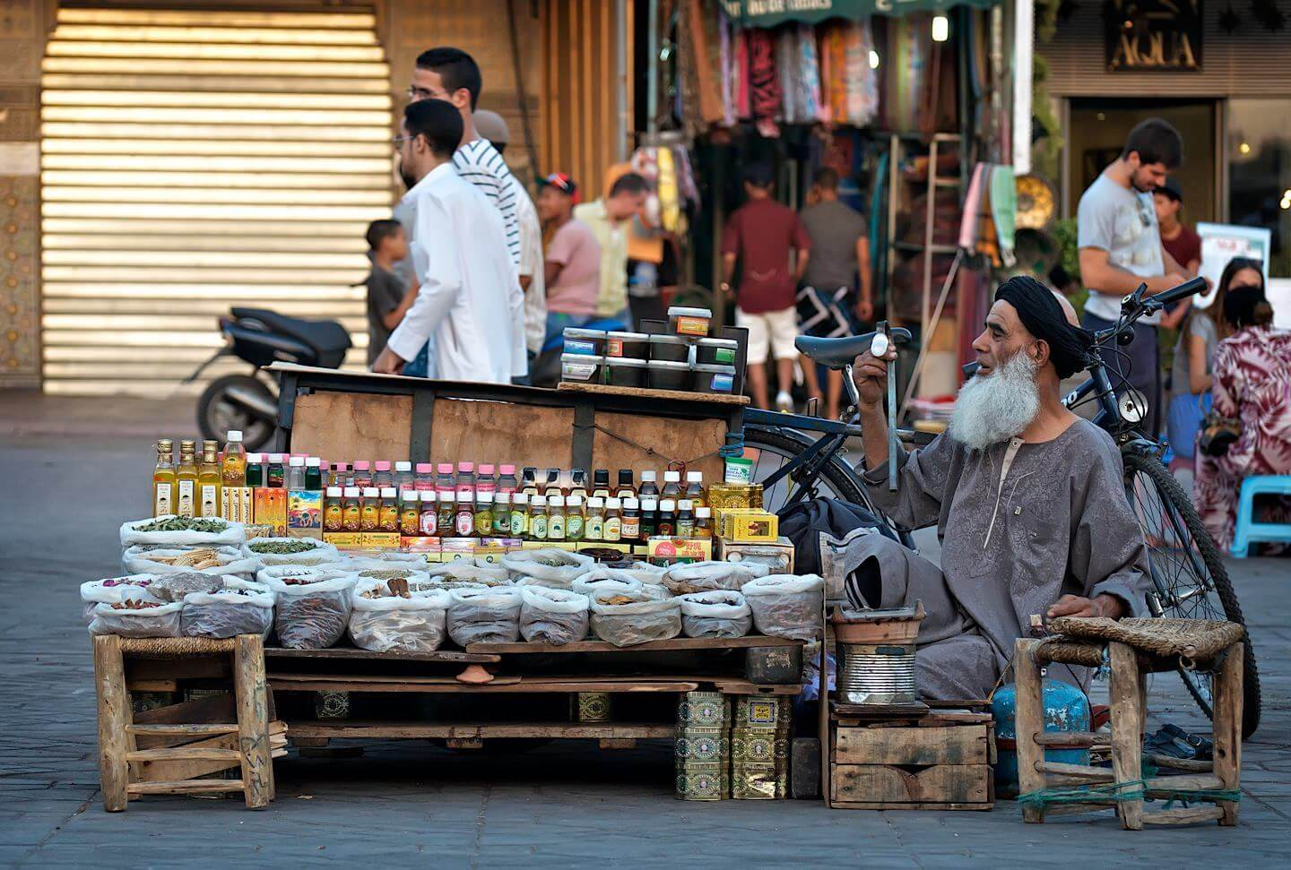 Old man with a beard selling stuff on the street; Marrakech