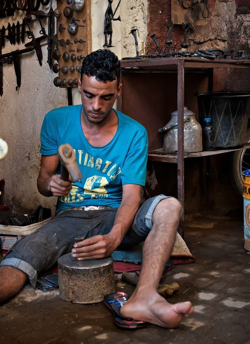Sitting metal worker; Marrakech