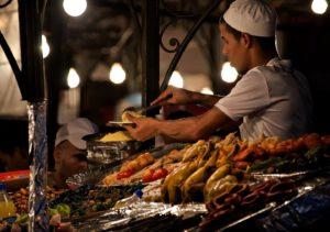 Moroccan cook serving food (Marrakech) - Photo by Zdenek Sindelar ~ CuriousZed