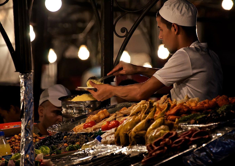 Moroccan cook serving food