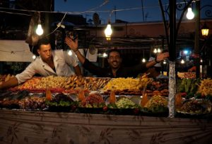 Moroccan restaurant owner greeting customers; Jemaa el-Fnaa square