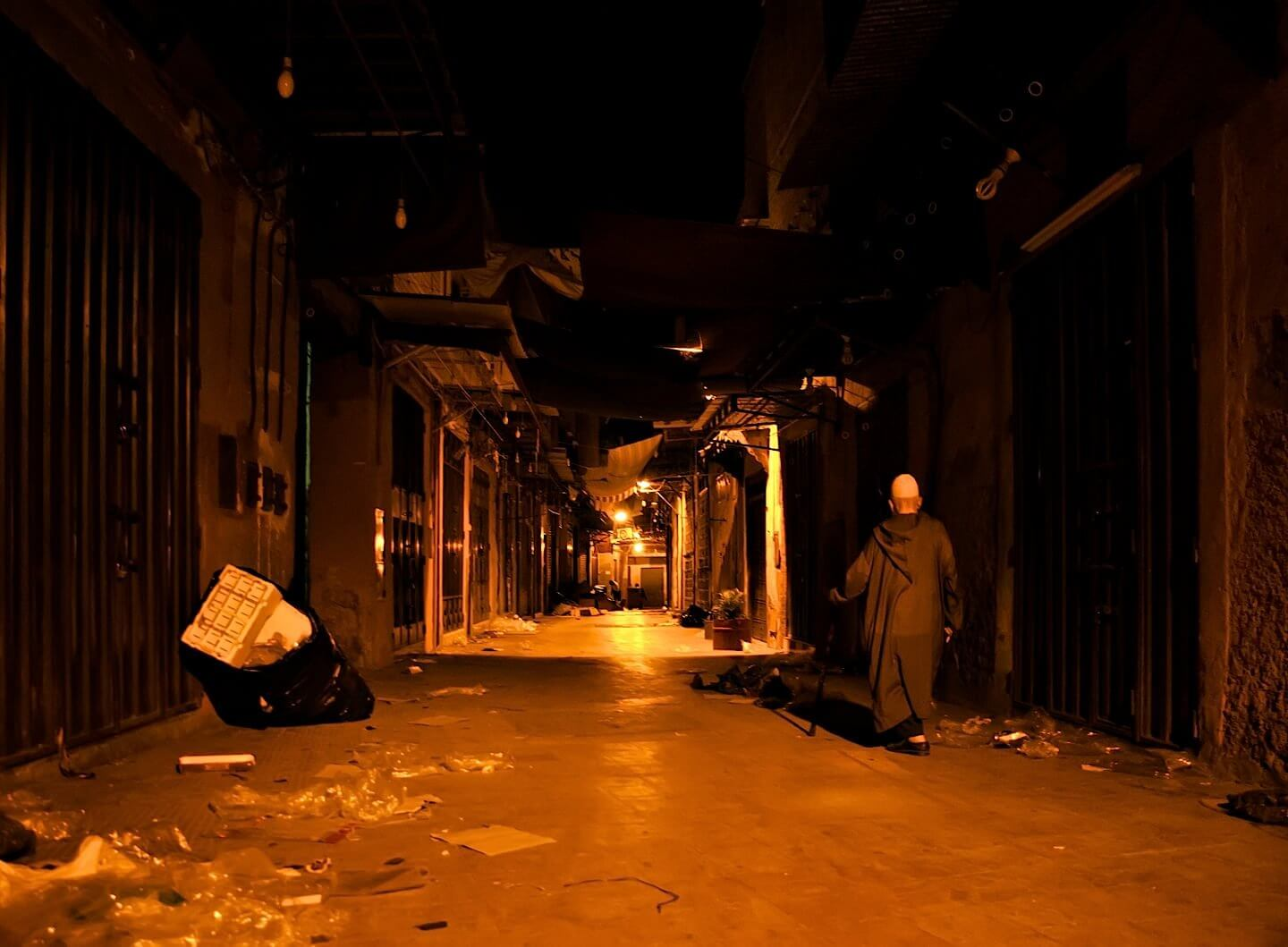 Empty alley of a souk in Marrakech late at night