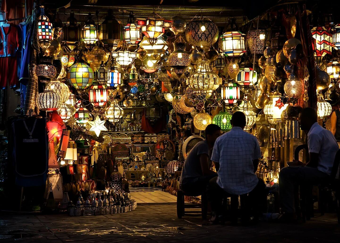 Night shot of a store selling traditional Moroccan lamps